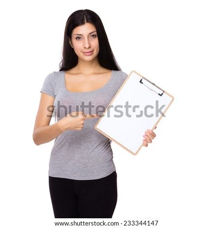 Woman finger point to white paper on clipboard