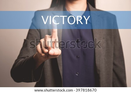 woman finger pointing at the camera with victory word - stock photo