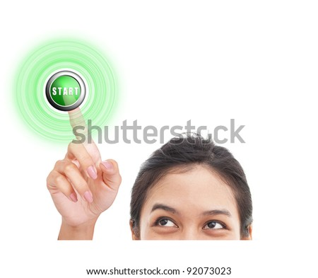 Woman finger pressing START button - stock photo