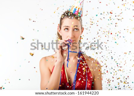 Woman fining birthday party boring with streamer being less than excited - stock photo