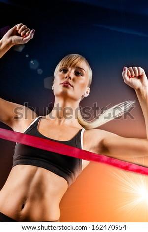 woman finishing through red tape - stock photo