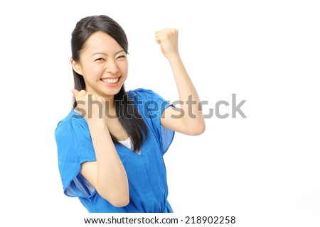 Woman fist pumped celebrating success - stock photo