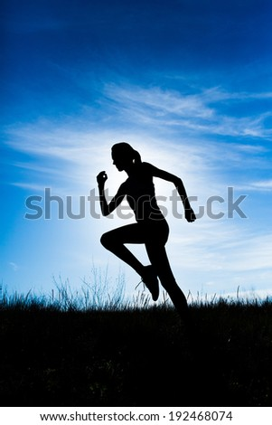 Woman fitness silhouette during sunrise jog workout wellness - stock photo