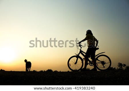 Woman fitness silhouette sunrise cycling workout wellness concept.