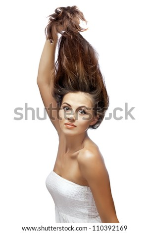 woman flaunting her healthy hair on white background