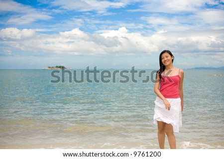 woman flipping her dress by the beach