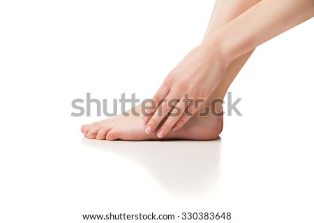 Woman foot on white background - stock photo