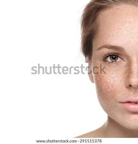 Woman freckle happy young beautiful studio portrait with healthy skin half  - stock photo