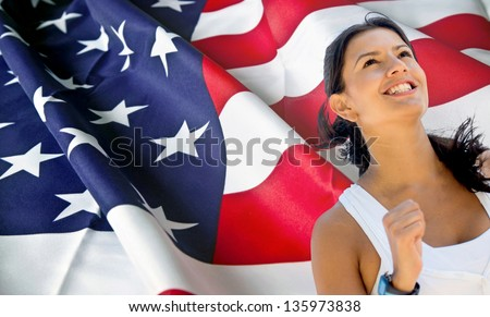 Woman from an American team running a marathon - stock photo