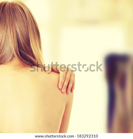 Woman from behind, naked body, pain concept - stock photo