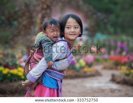 Woman from black hmong hill tribe of children girl smile - stock photo