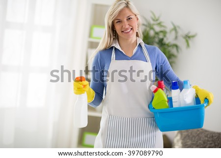Woman from cleaning service start to clean house - stock photo