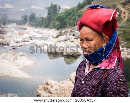 Woman from Red Dao minority group wearing traditional headdress near Ban Ho village in Sapa, Lao Cai, North Vietnam.