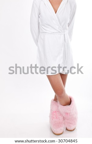 Woman (from toe to shoulder) in white bathrobe and pink boots with crossed legs on white background - stock photo