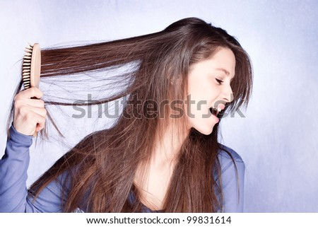 woman  frustrated with  her hair - stock photo