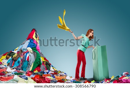 Woman gets clothes from the bag - stock photo