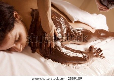 woman getting a chocolate rub at a local spa