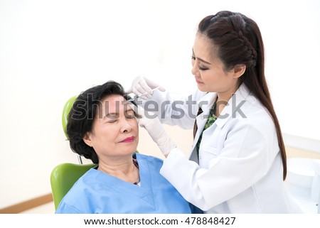 Woman getting a face lift with Botox