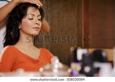 Woman getting a head massage - stock photo