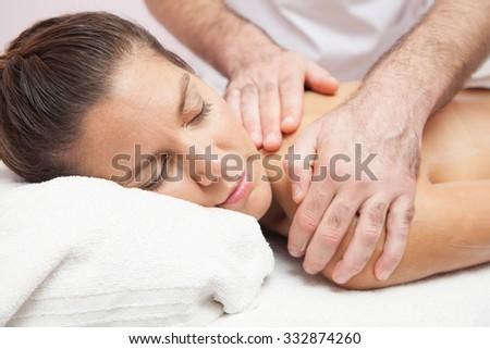 Woman getting a massage - stock photo