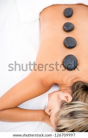 Woman getting a massage with hot stones