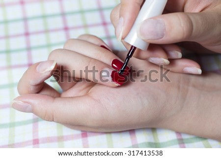 woman getting a nail manicure at nails salon - stock photo