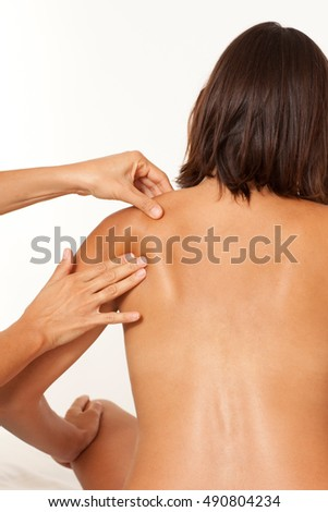 Woman getting a shoulder massage