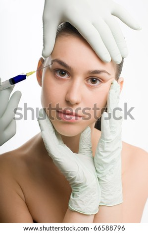 Woman getting an injection or hyaluronic, collagen,HA injection, beauty plastic surgery - stock photo