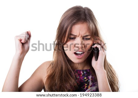 Woman getting bad news during conversation by mobile phone