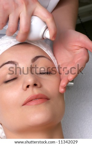 woman getting extra hydration procedure before skin cleaning at beauty salon