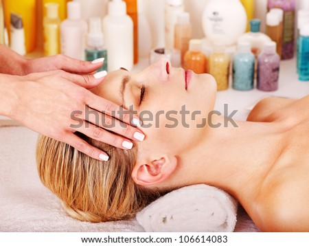 Woman getting facial  massage in beauty spa.