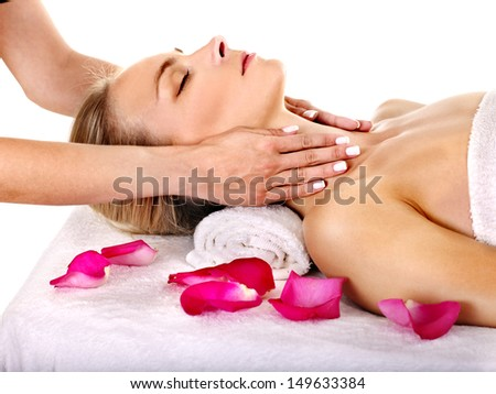 Woman getting facial  massage in beauty spa. Isolated. - stock photo
