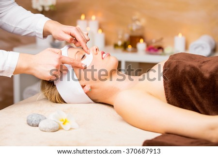 Woman getting gel eye mask