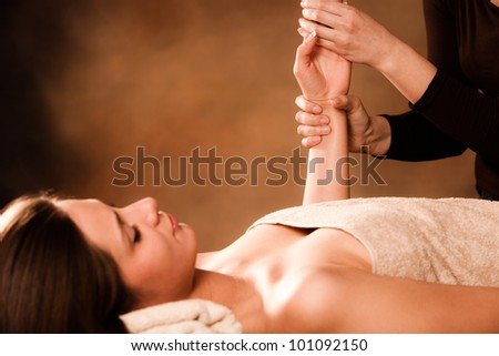 woman getting hand massage in spa salon - stock photo