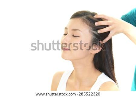 Woman getting head massage - stock photo