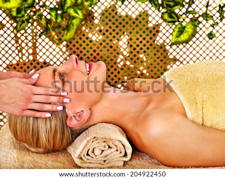 Woman getting head massage in tropical beauty spa. - stock photo