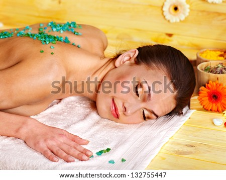 Woman getting  massage body salt scrub.