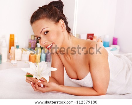 Woman getting massage in beauty spa. - stock photo