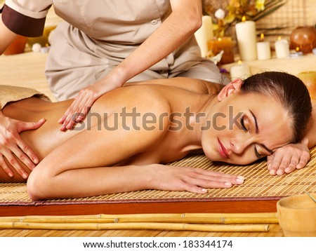 Woman getting  massage in spa. - stock photo