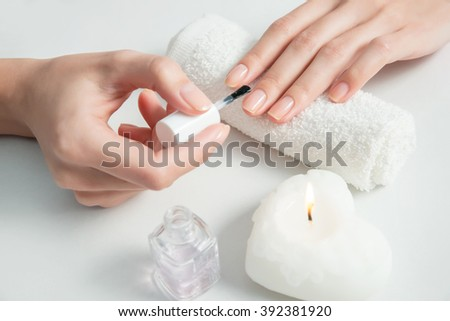 Woman getting nail manicure. Close up, selective focus. - stock photo