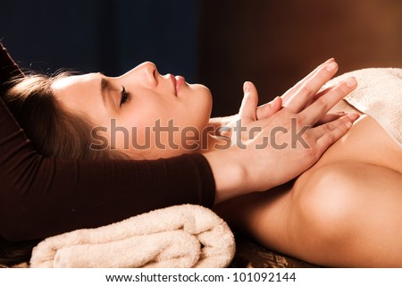 woman getting neck  massage in spa - stock photo
