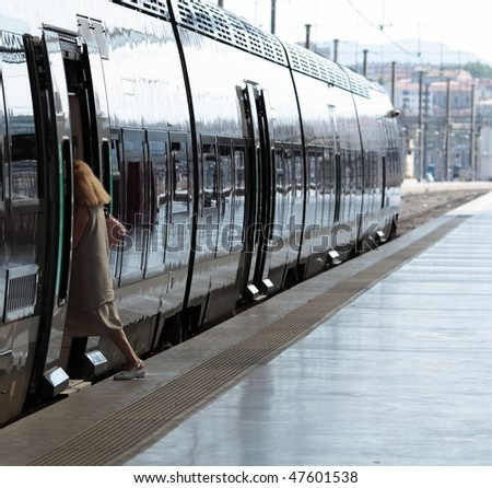 woman getting on a train - stock photo