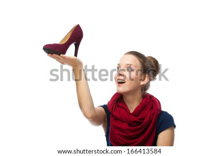 Woman getting shoes as gift or happy of her shopping. -  isolated over a white background  - stock photo