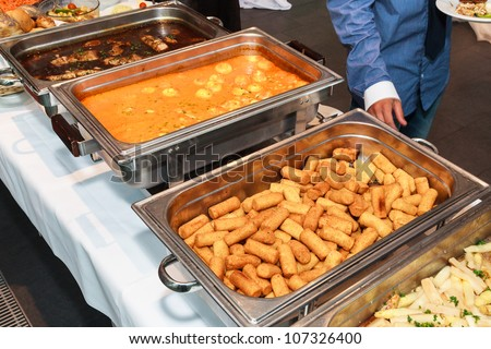 Woman getting starter plate from buffet - stock photo