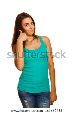 woman girl shows gesture of phone calls vest and jeans isolated in studio portrait