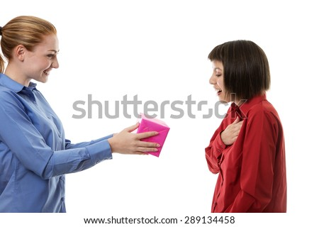 woman given a gift to her work friend  - stock photo