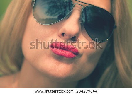 Woman gives a kiss - stock photo