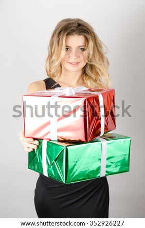 woman gives presents in a black dress