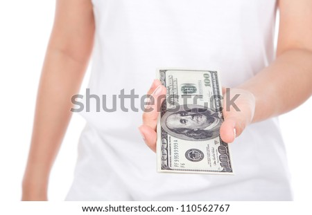 Woman giving a handful of dollars isolated on white background