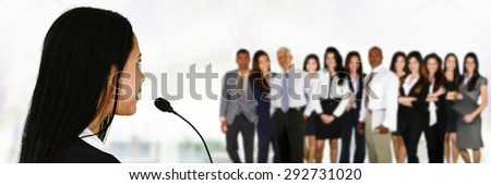Woman giving a speech at a convention - stock photo